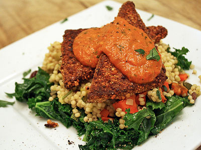 Cashew Crusted Tofu, Vegetable Israeli Couscous, Sauteed Kale, Roasted Red Pepper Coulis