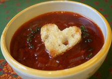 Red Onion And Red Wine Soup With Tomatoes, Thyme And Heart Shaped Croutons