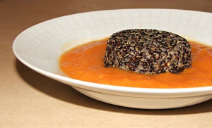 Orange vegetable soup with black quinoa