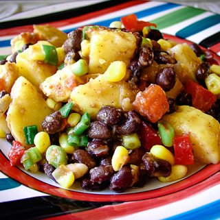Southwestern Black Bean Potato Salad: This vegan salad is a meal! Potatoes and black beans are seasoned with chipotle chiles for a spicy feast. #vegan
