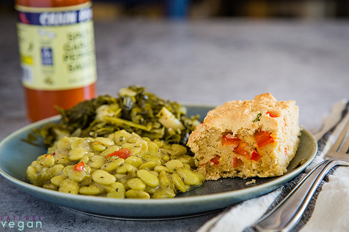 Confetti Cornbread on a plate with lima beans and turnip greens
