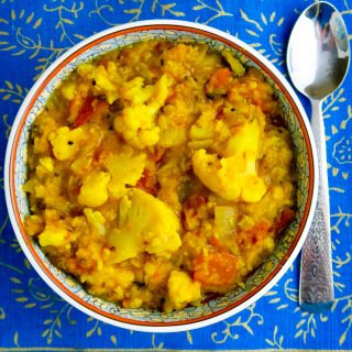 Red lentils and cauliflower are simmered with the Bengali 5-spice blend Panch Phoran in this delicious #vegan dal. #wfpb #wfpbno #veganww #weightwatchers #zeropoints
