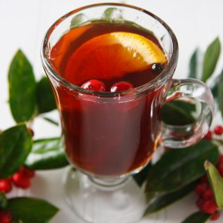 Cranberry Wassail: Instead of wine or ale, this apple and cranberry wassail uses fruit juices for sweetness and brandy for punch. It can be made with or without alcohol. #christmas #drinks