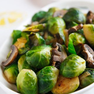 Super-Awesome Brussels Sprouts and Mushrooms: A simple vegan side dish of sauteed Brussels sprouts and mushrooms, seasoned with onion, garlic, and black pepper.