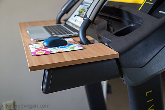 Treadmill desk rests on arms of treadmill
