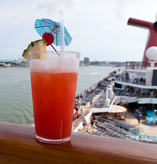 Having a drink during departure is a cruise tradition.