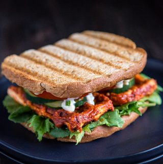 Barbecued Waffle Iron Tofu on a Sandwich with Lettuce, Tomatoes, and Cucumber