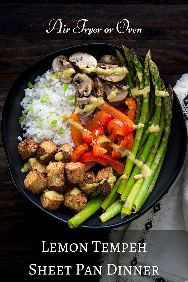 Lemon Tempeh Air Fryer Sheet Pan Dinner: Slightly crisp cubes of lemony tempeh are complemented by fresh green spears of asparagus, sweet red bell pepper, and plump mushrooms. Make it in the oven or in the Breville Smart Oven Air Fryer. #vegan