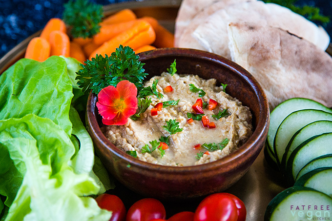 Baba ganoush (eggplant dip) with carrots, lettuce, tiny tomatoes, sliced cucumber, and pita bread
