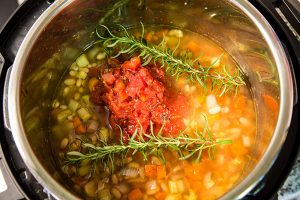 Tuscan white bean soup being prepared in the Instant Pot