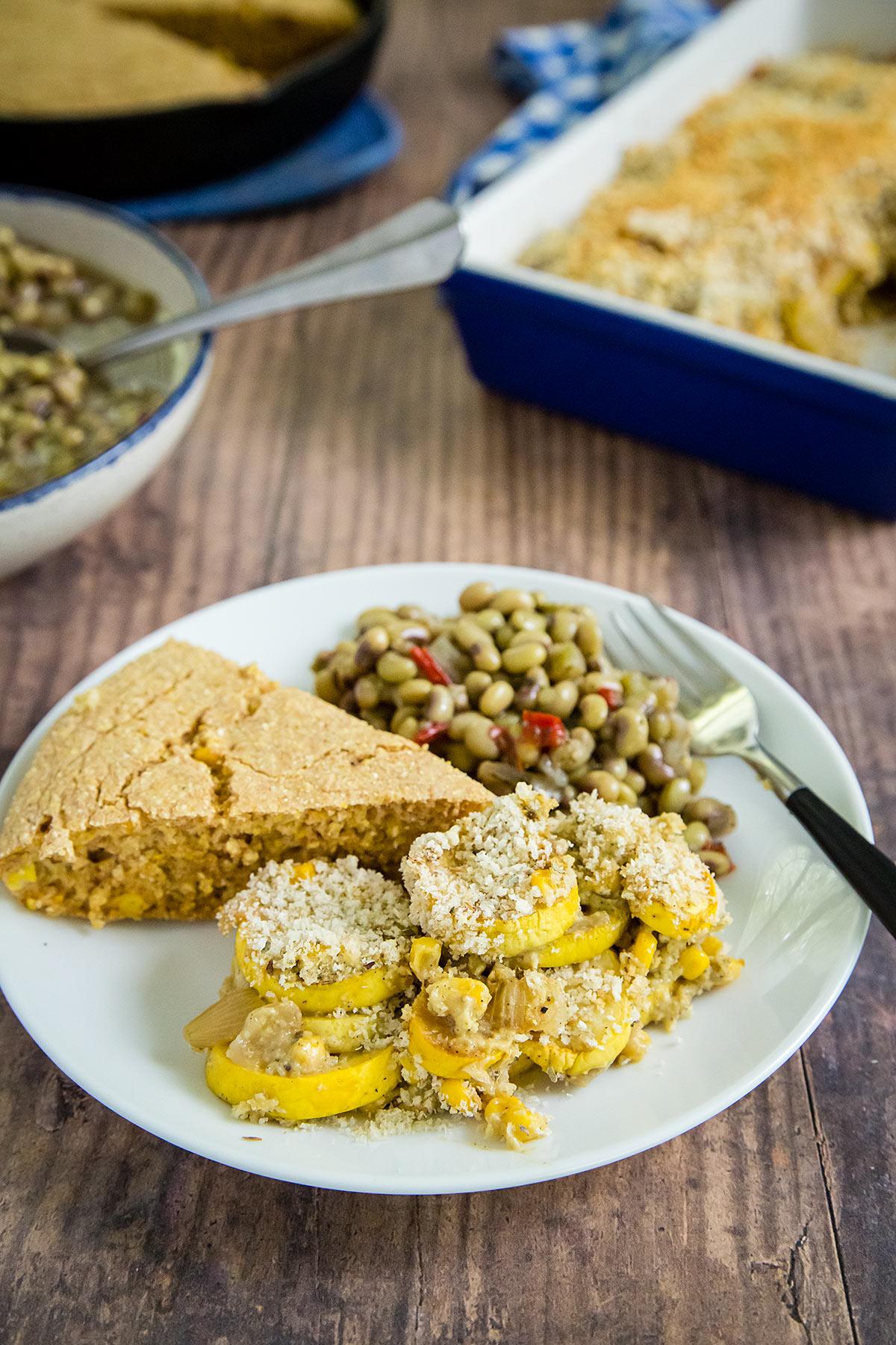 Squash and Corn Casserole with vegan cornbread and field peas